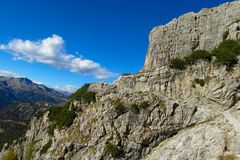 Roky cliff mountain walls, Dolomites. Roky cliff mountains of Dolomites yellow color at sunset. Dolomiti di Brenta, Italy, the Dolomites. Beautiful rocky peak Stock Image