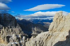 Dolomites rocky mountain wall landscape. Roky cliff mountains of Dolomites yellow color at sunset. Dolomiti di Brenta, Italy, the Dolomites. Beautiful rocky peak royalty free stock photography