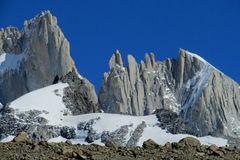 Roky mountains of Patagonia. Trekkers in Patagonia near Mount Fitz Roy. Rocky summit of beautiful Monte Fitz Roy, Cerro Chalten mountain range located near El Royalty Free Stock Images