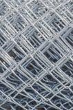 Rolado acima da cerca Pattern do elo de corrente do metal imagem de stock royalty free