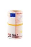 Rolado acima da moeda europeia Foto de Stock