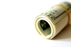 Rolado acima das contas de dólar Fotografia de Stock