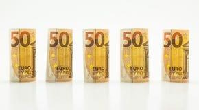 Rolado acima de 50 euro- cédulas nas fileiras Isolado em um fundo branco Fotografia de Stock Royalty Free