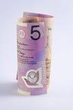 Rolado acima do Australian a nota de 5 dólares Fotos de Stock