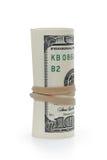 Rolado cem cédulas do dólar amarradas com Fotos de Stock Royalty Free