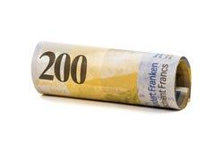Rolado 200 francos suíços de cédulas Fotografia de Stock Royalty Free