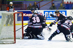 Roland Fink goalie  and Gruber Ingemar of Renon Ritten Sport and Tommaso Goi of HC Milano during a game Stock Images