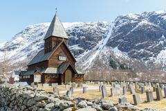 Roldal Stave Church Roldal stavkyrkje with snow cap mountain b Stock Images