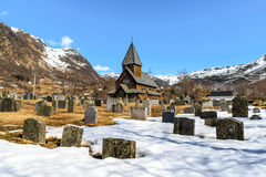 Roldal Stave Church Roldal stavkyrkje with snow graveyard fore Royalty Free Stock Photography