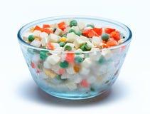 Role com vegetais congelados em um fundo branco Fotos de Stock Royalty Free