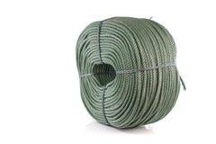 Role a corda de nylon verde grossa isolada no fundo branco Imagens de Stock Royalty Free