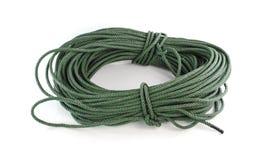 Role a corda de nylon verde grossa isolada no fundo branco Fotografia de Stock