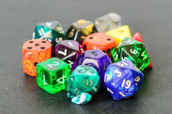 Role playing dices lying on black background Royalty Free Stock Photo