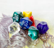 Role playing dices lying on picture background Royalty Free Stock Images