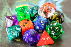 Role playing dices lying on picture background Stock Photography
