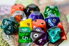 Role playing dices lying on picture background Royalty Free Stock Photo
