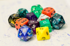 Role playing dices lying on sketch ma Royalty Free Stock Images