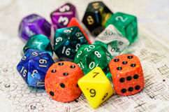 Role playing dices lying on sketch map Royalty Free Stock Photo