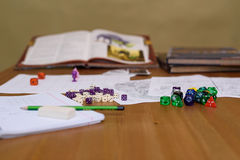 Role playing game set up on table on beige background Royalty Free Stock Photography