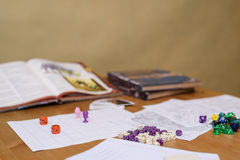 Role playing game set up on table on beige background Royalty Free Stock Photo