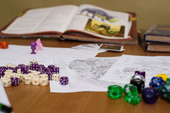 Role playing game set up on table on beige background. Stock photo Royalty Free Stock Photos