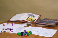 Role playing game set up on table on beige background Stock Images