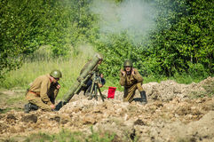 Roleplay - battle reenactment on the outskirts of Moscow during World war 2 in the Kaluga region in Russia. Stock Photography