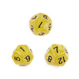 Roleplaying polyhedral dice isolated. Yellow roleplaying polyhedral dodecahedron gaming plastic dice isolated over the white background, set of three different Royalty Free Stock Photography