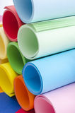 Roles of color paper. Color paper rolled and piled. Stack of paper on multicolor background royalty free stock photo