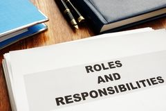 Roles and Responsibilities documents. On a desk stock photos
