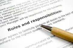 Roles and responsibilities with wooden pen. Close up royalty free stock photos