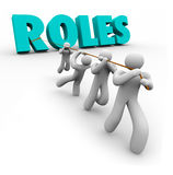 Roles Word Pulled by Team Members Jobs Duties Tasks Royalty Free Stock Photo