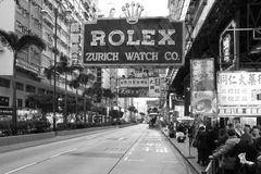 Rolex advertisment in Hong Kong. HONG KONG, CHINA - JANUARY 4, 2012: Vintage scene along the Nathan Road (Golden Mile), the main thoroughfare on the Kowloon side Stock Images