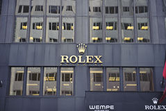 Rolex logo on store wall Royalty Free Stock Photography