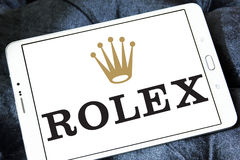 Rolex logo. Logo of swiss watches company rolex on samsung tablet Royalty Free Stock Images