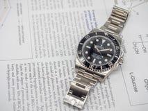 Rolex-Matrose auf einem U-Boot auf englischem Papier Stockfotografie