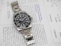Rolex-Matrose auf einem U-Boot auf englischem Papier Lizenzfreie Stockbilder