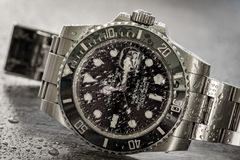 Rolex Submariner. Detailed view of an iconic, swiss-made men`s mechanical divers watch. stock photo