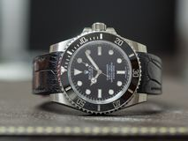 Rolex submariner no date on leather table Royalty Free Stock Image