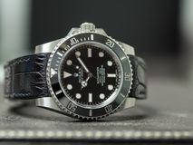 Rolex submariner no date on leather table Royalty Free Stock Photo