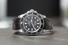 Rolex submariner no date on leather table Stock Photos