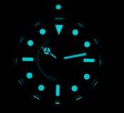 Rolex submariner with superluminova glow Stock Photography