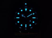 Rolex submariner with superluminova glow Stock Image