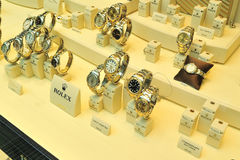 Rolex watches in showcase store Stock Images