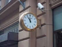 Rolex watches on the wall in the street of Helsinki. Beautiful Rolex watches on the wall Royalty Free Stock Photos