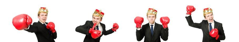 Rolig aff?rsman med krona- och boxninghandskar arkivfoton