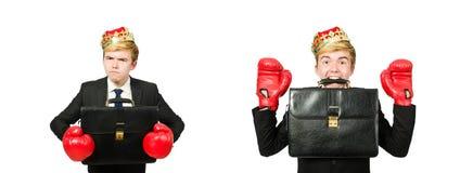 Rolig aff?rsman med krona- och boxninghandskar arkivbild