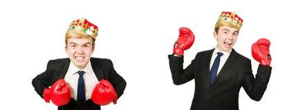 Rolig aff?rsman med krona- och boxninghandskar arkivfoto