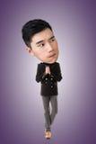Rolig asiatisk stor head man arkivfoton