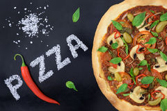Rolig design för pizza och för chilipeppar Arkivfoton